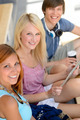 Three student friends with tablet smiling camera - PhotoDune Item for Sale
