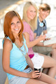 Three smiling student friends sitting summer - PhotoDune Item for Sale