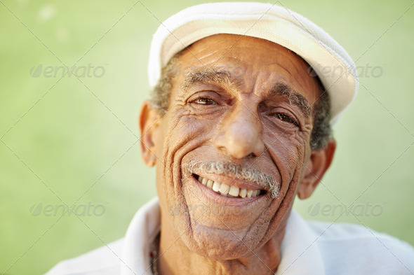 aged latino man smiling at camera - Stock Photo - Images