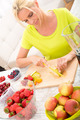 Mature woman preparing a smoothie - PhotoDune Item for Sale