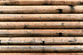 grungy background of cylindrical logs - PhotoDune Item for Sale