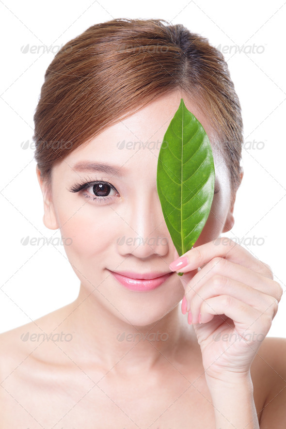 beautiful woman face portrait with green leaf - Stock Photo - Images