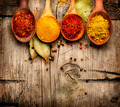 Spices and herbs. Curry, saffron, turmeric, cinnamon over wood - PhotoDune Item for Sale