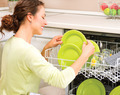 Dishwasher. Happy Young Woman in the Kitchen doing Housework - PhotoDune Item for Sale