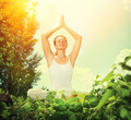 Young Woman doing Yoga Exercises Outdoor - PhotoDune Item for Sale