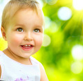 Little Baby Girl Portrait Outdoor. Smiling Cute Child - PhotoDune Item for Sale