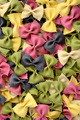 Multicolor uncooked farfalle pasta background - PhotoDune Item for Sale