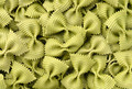Uncooked green spinach farfalle pasta background - PhotoDune Item for Sale
