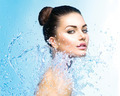 Beautiful girl under splash of water over blue background - PhotoDune Item for Sale