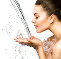 Beautiful model woman with splashes of water in her hands - PhotoDune Item for Sale