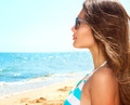 Beauty Girl Wearing Sunglasses over Ocean. Vacation Concept - PhotoDune Item for Sale
