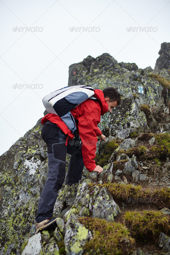 Teenage hiker on mountain - Stock Photo - Images