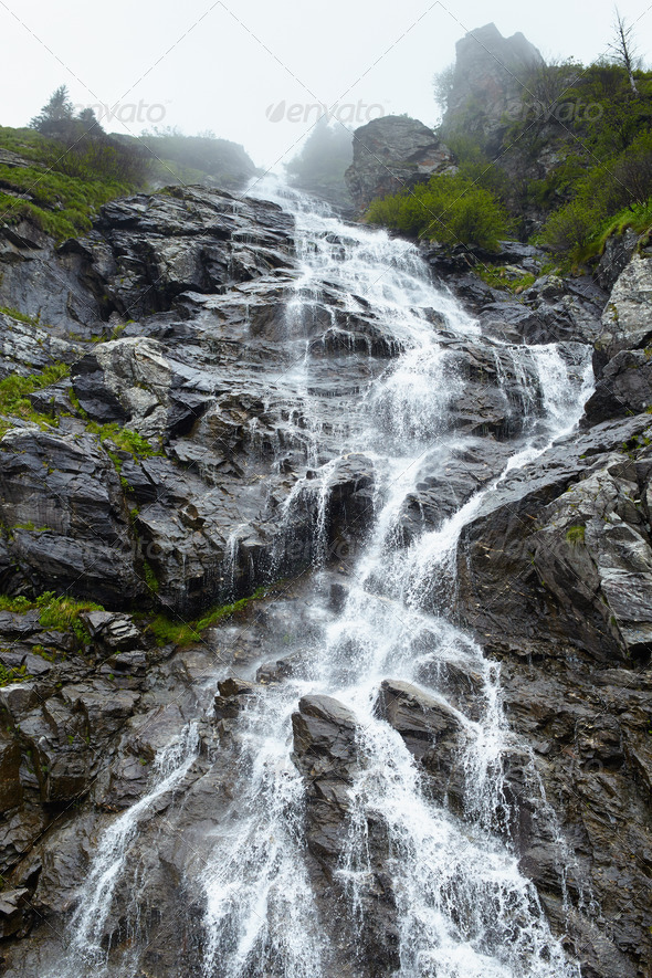 Waterfall on mountain - Stock Photo - Images
