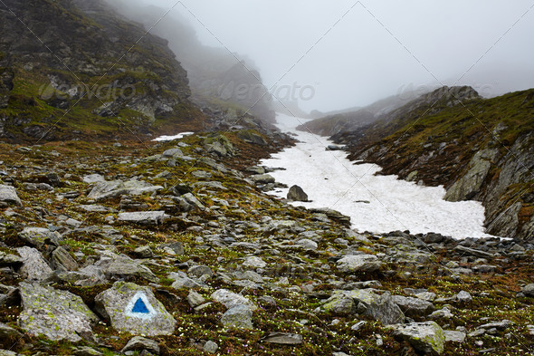 Misty mountains and hiking trail - Stock Photo - Images