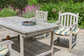 Wooden table and chairs in an ornamental garden - PhotoDune Item for Sale