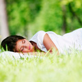 Woman sleeping on grass - PhotoDune Item for Sale