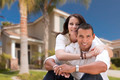 Young Happy Hispanic Young Couple in Front of Their New Home. - PhotoDune Item for Sale