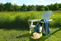 Jeans laying on adirondack chair in field - PhotoDune Item for Sale