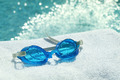 Swimming goggles on towel - PhotoDune Item for Sale