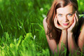 Woman laying in a green field - PhotoDune Item for Sale