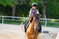 child trains horse riding ,