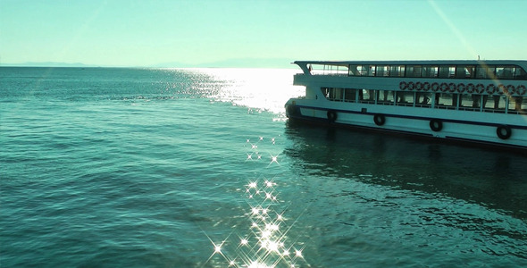 Sunlight Reflection On The Sea Water And Ferryboat
