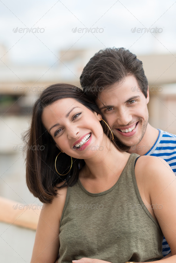 Smiling happy woman with her husband - Stock Photo - Images