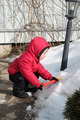 child playing in the snow with a spade - PhotoDune Item for Sale