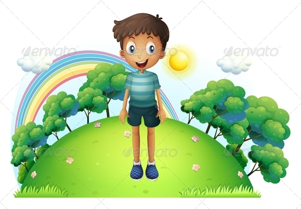 A Boy Standing in the Middle of the Hill