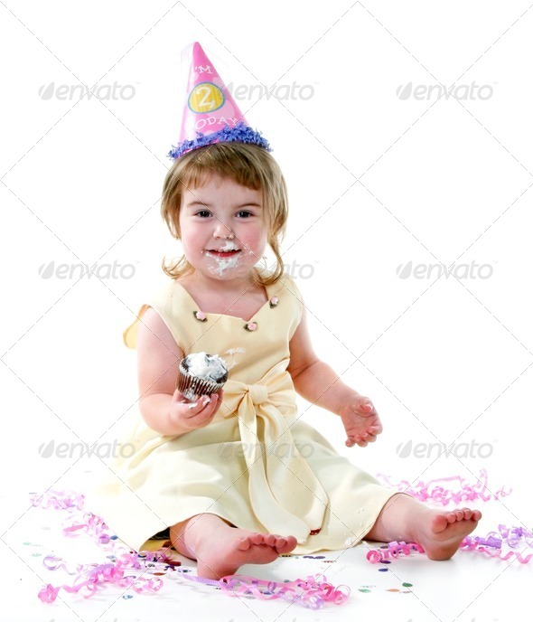Birthday Girl Enjoying Her Birthday Cake on White - Stock Photo - Images