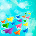 Set of flying color paper planes on the blue blurred background - PhotoDune Item for Sale
