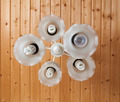 Close-up of a white chandelier with eco bulb - PhotoDune Item for Sale