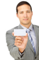 Composed young businessman holding a white card