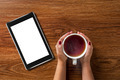woman holding cup of tea with tablet pc on wood - PhotoDune Item for Sale