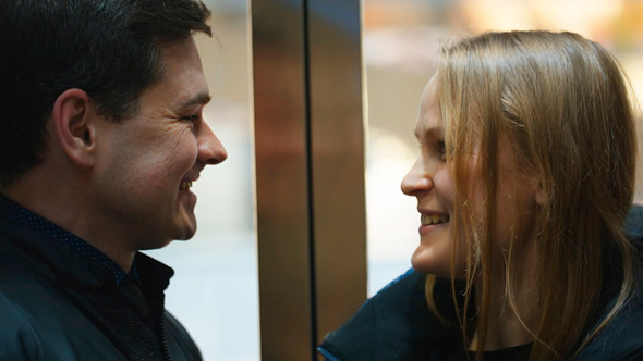 Man And Woman Talking Vividly In Lift
