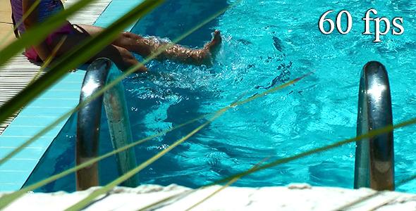 Little Girl Having Fun Near the Pool