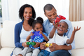 Happy Afro-american family playing video games