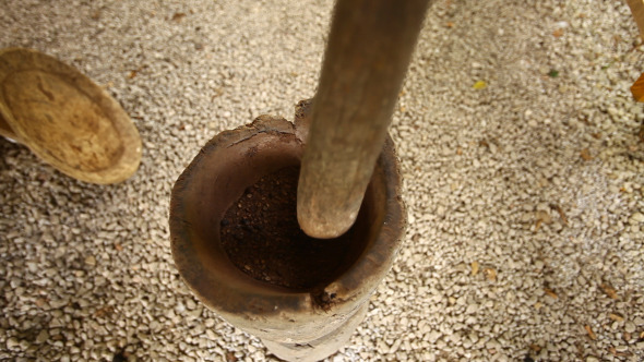 Traditional Process Of Grinding Coffee Beans