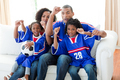 Afro-American family celebrating a goal at home