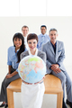 Confident business people holding a terrestrial globe
