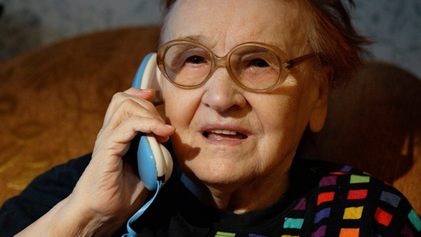 Elderly Woman In Glasses Taking A Call