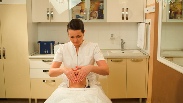 Facial Treatment With Massage Therapist