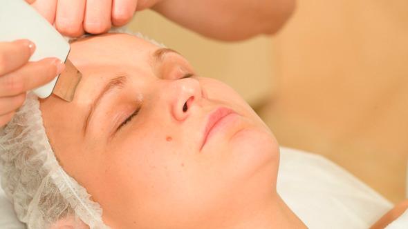 Young Woman Taking Facial Treatments Of Ultrasonic