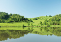 Beautiful summer landscape with green hills reflected in the calm water - PhotoDune Item for Sale
