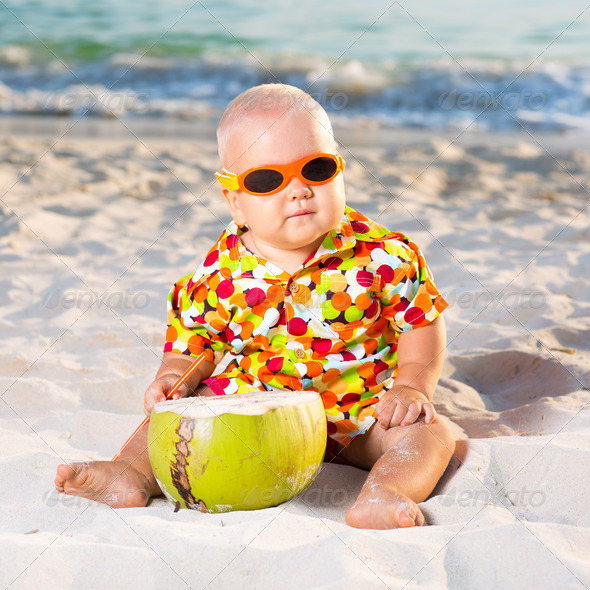 Baby with coconut - Stock Photo - Images