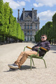 Young man hipster resting in the Tuileries Gardens in Paris, Fra - PhotoDune Item for Sale