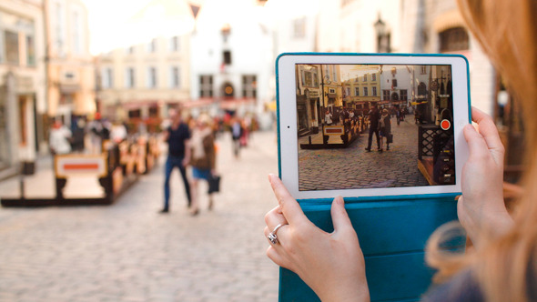 Woman With Tablet Making Video Of Street In Tallin