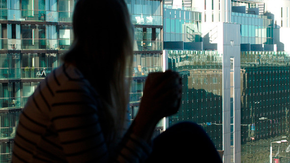 Woman At The Window With Mug Looking At The City