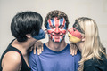 Happy friends with painted flags on faces kissing - PhotoDune Item for Sale