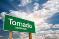 Tornado Green Road Sign with Dramatic Clouds and Sky. - PhotoDune Item for Sale